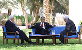 United States President George W. Bush, center, discusses the Middle East peace process with Prime Minister Ariel Sharon of Israel, left, and Palestinian Prime Minister Mahmoud Abbas in Aqaba, Jordan, Wednesday, June 4, 2003. .Mandatory Credit: Paul Morse - White House via CNP