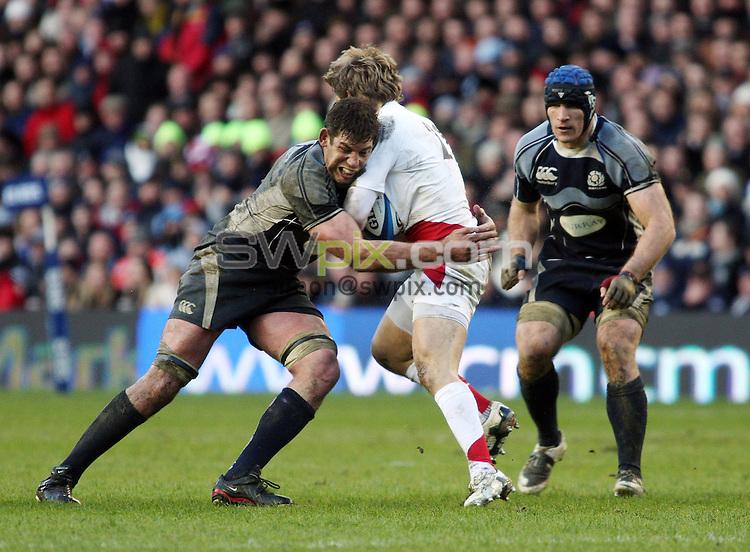 PICTURE BY JEREMY RATA/SWPIX.COM - Rugby Union - RBS Six Nations - Scotland v England - Murrayfield, Edinburgh, Scotland - 08/03/08...Copyright - Simon Wilkinson - 07811267706..Scotland's Nathan Hines tackles England's Matthew Tait.