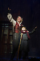 London, UK. 31.10.2012. Bill Kenwright presents Tommy Steele in SCROOGE, the musical, at the London Palladium. Picture shows:  Tommy Steele (Ebenezer Scrooge) and James-Tobias Norrington (Tiny Tim). Photo credit: Jane Hobson.