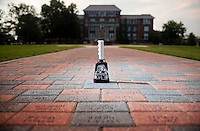 Cowbell with spotlight on Drill Field Walk of Honor