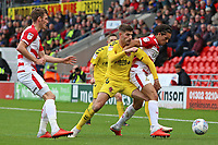 Fleetwood Town's Ched Evans battles with Doncaster Rovers' Niall Mason<br /> <br /> Photographer David Shipman/CameraSport<br /> <br /> The EFL Sky Bet League One - Doncaster Rovers v Fleetwood Town - Saturday 6th October 2018 - Keepmoat Stadium - Doncaster<br /> <br /> World Copyright &copy; 2018 CameraSport. All rights reserved. 43 Linden Ave. Countesthorpe. Leicester. England. LE8 5PG - Tel: +44 (0) 116 277 4147 - admin@camerasport.com - www.camerasport.com