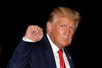 United States President Donald J. Trump pumps his fist as he walks on the South Lawn of the White House upon his return to Washington from Tampa, Florida on July  31, 2020. <br /> Credit: Yuri Gripas / Pool via CNP /MediaPunch