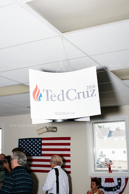 Campaign signs hang from the ceiling before Texas senator and Republican presidential candidate Ted Cruz speaks to a crowd at the kick-off event at his New Hampshire campaign headquarters in Manchester, New Hampshire.