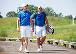 MUSCLE SHOALS, AL - MAY 25: West Florida Coach Steve Fell walks across the bridge to the No. 9 tee box with Henry Westmoreland during the Division II Men's Team Match Play Golf Championship held at the Robert Trent Jones Golf Trail at the Shoals, Fighting Joe Course on May 25, 2018 in Muscle Shoals, Alabama. Lynn defeated West Florida 3-2 to win the national title. (Photo by Cliff Williams/NCAA Photos via Getty Images)