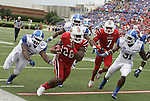 Jeremy Wright runs the ball during the second half of the game against the University of Kentucky Wildcats on Sunday, Sept. 2, 2012 in Papa John's Stadium in Louisville, Ky. Louisville won 32-14. Photo by Latara Appleby | Staff