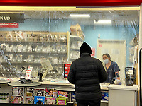 New York, New York City. CVS pharmacy takes precautions for its workers and customers with plastic coverings.