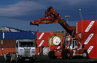 Containers being unloaded from a truck on the quay, Marseille Port, France.