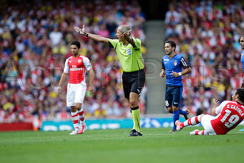 03.08.2014. London, England. Emirates Cup.  Arsenal versus AS Monaco.  referee Martin ATKINSON  With Monaco winning 0-1 and Valencia winning earlier in the day, Valencia won the tournament trophy.