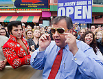 SEASIDE HEIGHTS, NJ (May, 24, 2013) — New Jersey Gov. Chris Christie rocks a pair of ornate sunglasses he received from Elvis impersonator Craig Newell (left) of Brant Beach as the Governor works the crowd on the Seaside Heights Boardwalk during an appearance on NBC's Today show.