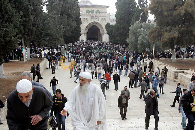 "Palestinians walk after Friday prayers at Al-Aqsa mosque compound in Jerusalem's old city on Nov. 4,2011, ahead of the Muslim Eid al-Adha festival at the end of the week. Muslims across the world are preparing to celebrate the annual ""Festival of Sacrifice"", which marks the end of the Hajj pilgrimage to Mecca and in commemoration of Prophet Abraham's readiness to sacrifice his son to show obedience to God. Photo by Mahfouz Abu Turk"