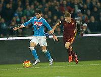 Napoli's Elseid Hysajand  AS Roma's Lucas Digne fight for the ball with during the  italian serie a soccer match,between SSC Napoli and AS Roma       at  the San  Paolo   stadium in Naples  Italy ,December 13, 2015