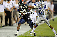 4 December 2010:  FIU running back Darriet Perry (28), attempts to evade Middle Tennessee cornerback Rod Issac (6) while turning a short pass into a 30 yard gain in the second quarter as the Middle Tennessee State University Blue Raiders defeated the FIU Golden Panthers, 28-27, at FIU Stadium in Miami, Florida.