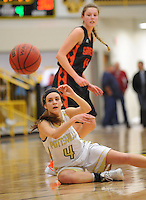 NWA Democrat-Gazette/ANDY SHUPE<br /> Katie Cormier of Pottsville comes up with a steal as Sydney Hicks of Gravette looks on Wednesday, Feb. 24, 2016, during the second half of play in the 4A North Regional Tournament in Tiger Arena in Prairie Grove. Visit nwadg.com/photos to see more photographs from the game.