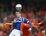 Steven Davis wins the ball in the air from Scott Robertson