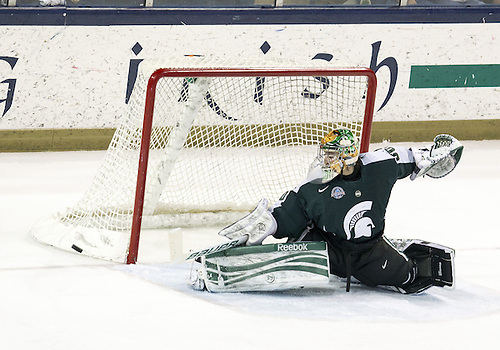 December 07, 2012:  Michigan State goaltender Jake Hildebrand (#30) makes the save during NCAA Hockey game action between the Notre Dame Fighting Irish and the Michigan State Spartans at Compton Family Ice Arena in South Bend, Indiana.  Notre Dame defeated Michigan State 3-2.