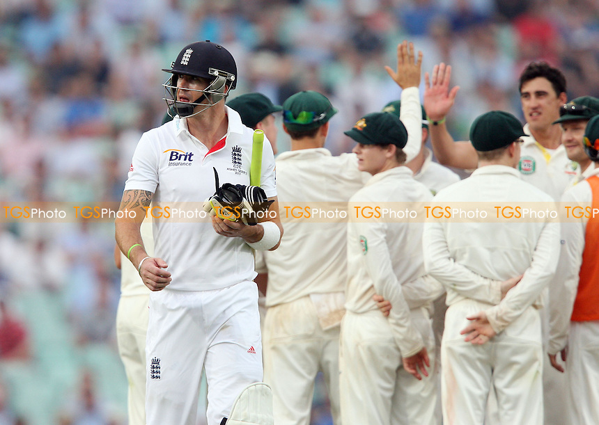 Kevin Pietersen of England walks off after losing his wicket - England vs Australia - 3rd day of the 5th Investec Ashes Test match at The Kia Oval, London - 23/08/13 - MANDATORY CREDIT: Rob Newell/TGSPHOTO - Self billing applies where appropriate - 0845 094 6026 - contact@tgsphoto.co.uk - NO UNPAID USE