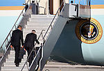 President Barack Obama and Senate Majority Leader Harry Reid board Air Force One at the Reno-Tahoe International airport, Tuesday, Aug. 21, 2012, after campaigning in Reno, Nev..Photo by Cathleen Allison