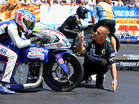 Jun 7, 2015; Englishtown, NJ, USA; NHRA pro stock motorcycle rider Hector Arana Jr is lined up by John Nobile during the Summernationals at Old Bridge Township Raceway Park. Mandatory Credit: Mark J. Rebilas-