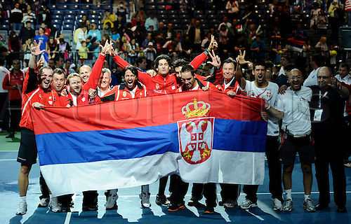 19.09.2010 Serbian tennis team members celebrate the victory after the last set of the semifinal match of the Davis Cup tennis tournament in Belgrade. Janko Tipsarevic of Serbia beat Radek Stepanek of the Czech Republic with 3-0, and sent Serbia into Davis Cup final for first time.