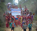 Women march together in celebration of International Women's Day on March 8, 2016, in Dhawa, a village in the Gorkha District of Nepal. <br /> <br /> The banner reads, &quot;106th International Women's Day&quot; and &quot;Implement the Constitution and Guarantee Women's Rights.&quot;