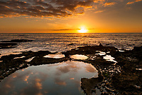Sunset viewed from limestone rocks with water pools in Punakaiki, Paparoa National Park, West Coast, Buller Region, New Zealand, NZ