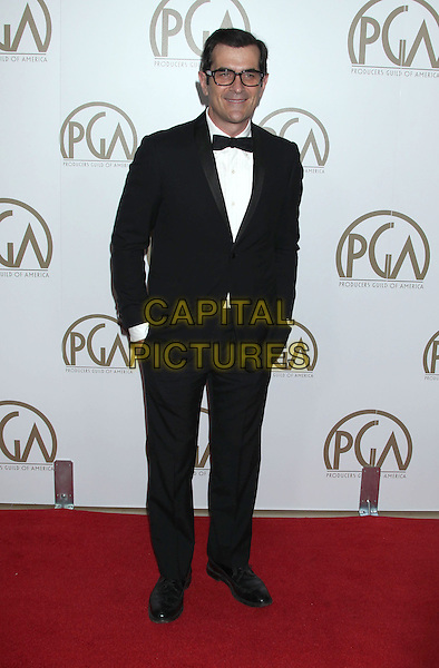 Ty Burrell.At the 24th Annual Producers Guild Awards held at the Beverly Hilton Hotel, Beverly Hills, California, USA,.26th January 2013..PGAs PGA arrivals full length hands in pockets black white bow tie glasses tuxedo.CAP/ADM/RE.©Russ Elliot/AdMedia/Capital Pictures.