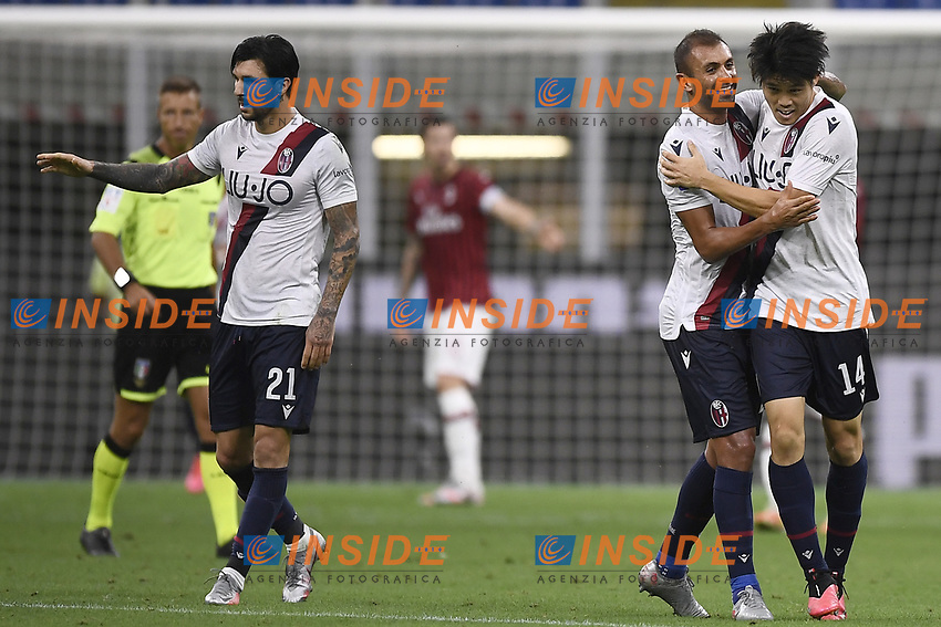 Takehiro Tomiyasu of Bologna FC celebrates with Danilo after scoring a goal during the Serie A football match between AC Milan and Bologna FC at stadio Giuseppe Meazza in Milano ( Italy ), July 18th, 2020. Play resumes behind closed doors following the outbreak of the coronavirus disease. <br /> Photo Image Sport / Insidefoto
