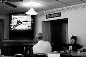 Elizabeth City, North Carolina.USA.March 26, 2003..In Elizabeth City's Circle Restaurant a large screen TV plays the FOX News perspective of the US war against Iraq from morning to night.