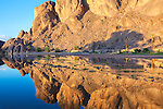 Mountain with reflections in a river, Fint Oasis, Ouarzazate, Morocco.