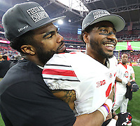 Ohio State Buckeyes running back Ezekiel Elliott (15) hugs Ohio State Buckeyes wide receiver Braxton Miller (1) after the Buckeyes victory over Notre Dame 44-28 in the Fiesta Bowl at University of Phoenix Stadium in Glendale, AZ on January 1, 2016.  (Chris Russell/Dispatch Photo)