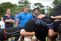 Forwards coach Neal Hatley shouts out instructions and encouragement as the Bath pack scrummage against Bristol Rugby. Bath Rugby training session on August 21, 2012 at Farleigh House in Bath, England. Photo by: Patrick Khachfe/Onside Images