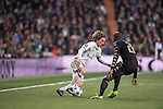 Luka Modric of Real Madrid  fights for the ball with Kalidou Koulibaly of SSC Napoli during the match Real Madrid vs Napoli, part of the 2016-17 UEFA Champions League Round of 16 at the Santiago Bernabeu Stadium on 15 February 2017 in Madrid, Spain. Photo by Diego Gonzalez Souto / Power Sport Images