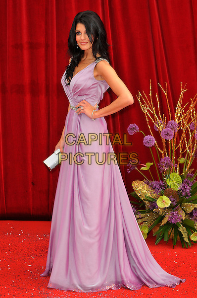 NATALIE ANDERSON .Attending the British Soap Awards 2011, .Granada Television Studios, Quay Street, Manchester, England, UK, .March 14th 2011..arrivals full length purple long maxi dress side lilac hand on hip sleeveless .CAP/CAS.©Bob Cass/Capital Pictures.