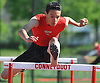 Matt Ferrer of Connetquot races to victory in the 110 meter hurdles event during a Suffolk County boys' track and field meet against Middle Country at Connetquot High School on Thursday, May 14, 2015. He finished with a time of 14.6 seconds.<br /> <br /> James Escher