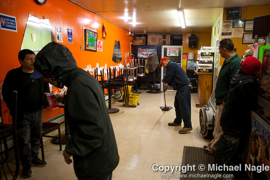 QUEENS, NY -- OCTOBER 25, 2013:  Christopher Canale, 51, mops the floor of the Master Express Deli & Restaurant in Willets Point on October 25, 2013 in Queens, NY.  PHOTOGRAPH  BY MICHAEL NAGLE FOR THE NEW YORK TIMES