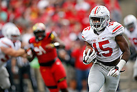 Ohio State Buckeyes running back Ezekiel Elliott (15) rushes upfield during the Buckeyes' 52-24 win over the Maryland Terrapins in the NCAA football game at Byrd Stadium in College Park, Maryland on Oct. 4, 2014. (Adam Cairns / The Columbus Dispatch)