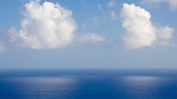While hiking up Diamond Head, I noticed these two clouds and thought their reflections in the deep blue ocean made a simple and beautiful composition.  This is essentially a horizontal crop of the previous image in this gallery.<br /> <br /> Canon EOS 5D, 24-105L lens