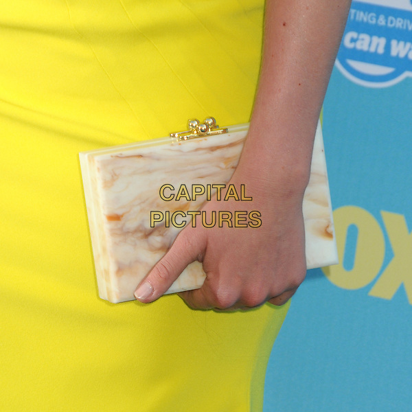 Leven Rambin's bag<br /> 2013 Teen Choice Awards - Arrivals held at Gibson Amphitheatre, Universal City, California, USA. <br /> August 11th, 2013<br /> hand detail yellow clutch white marble<br /> CAP/ADM/BP<br /> &copy;Byron Purvis/AdMedia/Capital Pictures