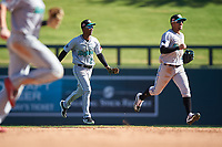 Salt River Rafters second baseman Jose Devers (2) and Victor Victor Mesa (10), both of the Miami Marlins organization, celebrate after winning the Arizona Fall League Championship Game against the Surprise Saguaros on October 26, 2019 at Salt River Fields at Talking Stick in Scottsdale, Arizona. The Rafters defeated the Saguaros 5-1. (Zachary Lucy/Four Seam Images)