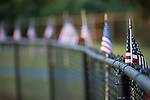 American Flags line the fence around Coach Joe Popp Stadium during the Patriot Bowl between the A.L. Brown Wonders and the Mooresville Blue Devils on September 9, 2016, in Mooresville, North Carolina.  The Blue Devils defeated the Wonders 23-21.  (Brian Westerholt/Special to the Tribune)