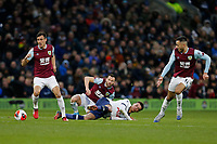 7th March 2020; Turf Moor, Burnley, Lanchashire, England; English Premier League Football, Burnley versus Tottenham Hotspur; Dele Alli of Tottenham Hotspur is left on the ground after being outnumbered by Jack Cork, Phil Bardsley and Dwight McNeil of Burnley in midfield