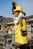 Salisbury, Massachusetts.Fisherman sculpture at a seafood restaurant is typical folk art