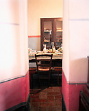ITALY, Siena, interior of empty dining table at the Castello Di Spannochia.