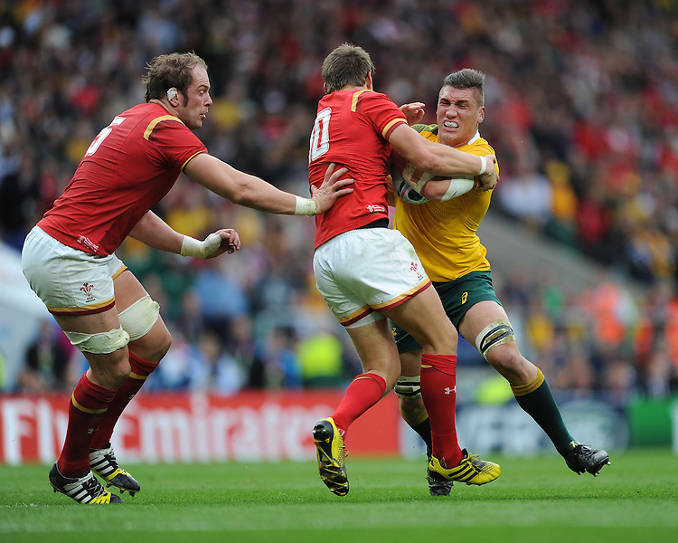 Sean McMahon of Australia is tackled by Dan Biggar of Wales as Alun Wyn Jones of Wales supports during Match 35 of the Rugby World Cup 2015 between Australia and Wales - 10/10/2015 - Twickenham Stadium, London<br /> Mandatory Credit: Rob Munro/Stewart Communications