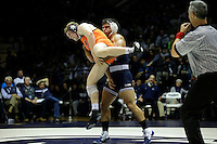STATE COLLEGE, PA -DECEMBER 19: Morgan McIntosh of the Penn State Nittany Lions wrestles Jared Haught of the Virginia Tech Hokies during their 197 pound bout on December 19, 2014 at Recreation Hall on the campus of Penn State University in State College, Pennsylvania. Penn State won 20-15. (Photo by Hunter Martin/Getty Images) *** Local Caption *** Morgan McIntosh;Jared Haught