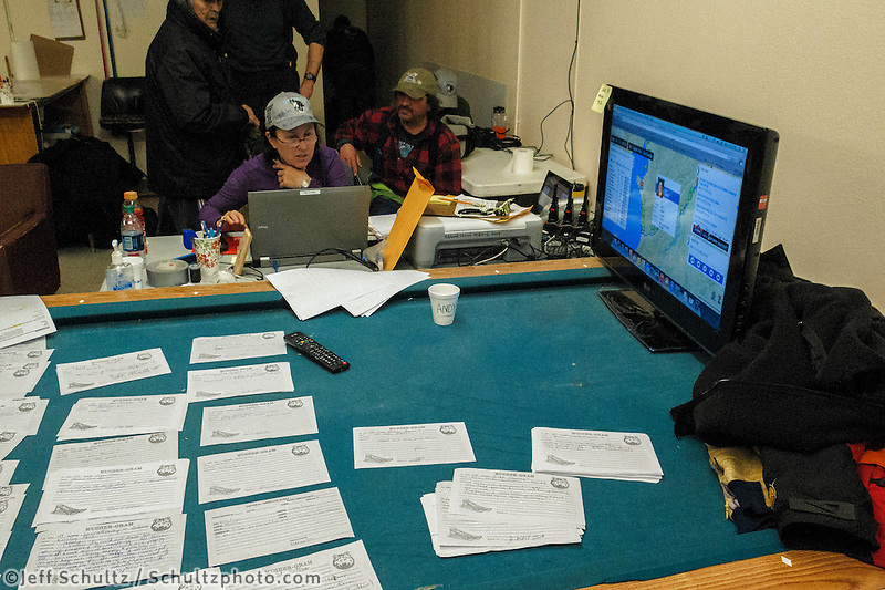 Nancy Yoshida works the comms table at the Unalakleet checkpoint on Monday March 16, 2015 during Iditarod 2015.  <br /> <br /> (C) Jeff Schultz/SchultzPhoto.com - ALL RIGHTS RESERVED<br />  DUPLICATION  PROHIBITED  WITHOUT  PERMISSION