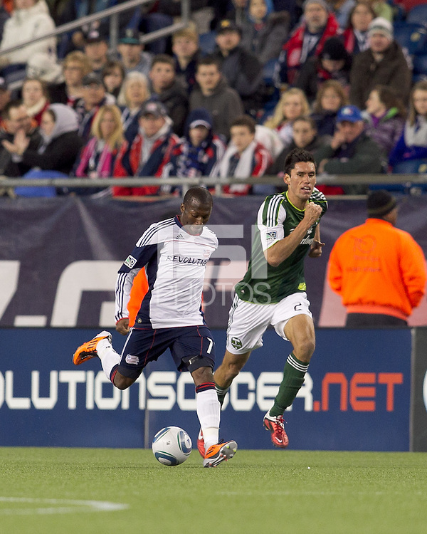 New England Revolution forward Sainey Nyassi (17) passes the ball as Portland Timbers defender Steve Purdy (25) closes. In a Major League Soccer (MLS) match, the New England Revolution tied the Portland Timbers, 1-1, at Gillette Stadium on April 2, 2011.