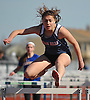 Carly Schwartz, a Byram Hills senior, races to victory in the girls 100 meter high hurdles event during the Cougar Invitational held at Bellmore JFK High School on Saturday, Apr. 16, 2016. She finished with a time of 16.2.