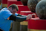 HAINAN ISLAND, CHINA - AUGUST 24:  Vytautas Lalas of Lithuania competes at the Atlas Stones event during the World's Strongest Man competition at Yalong Bay Cultural Square on August 24, 2013 in Hainan Island, China.  Photo by Victor Fraile
