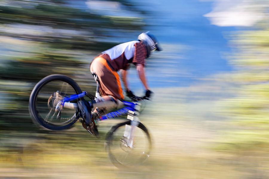 Rider performs a stoppy on mountain bike, Alberta, Canada